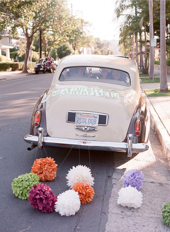 wedding car decoration with pom poms