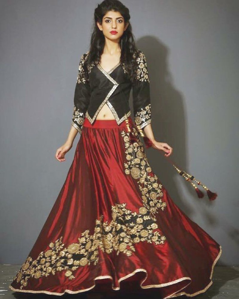 All-time favorite black criss-cross blouse with shiny red lehenga