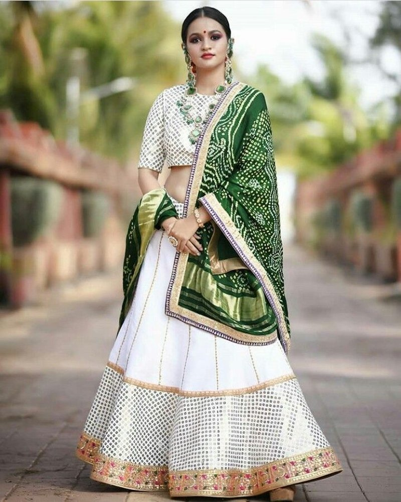 Beautiful crisp zari worked white lehenga with ethnic green chunni, Rajasthani style