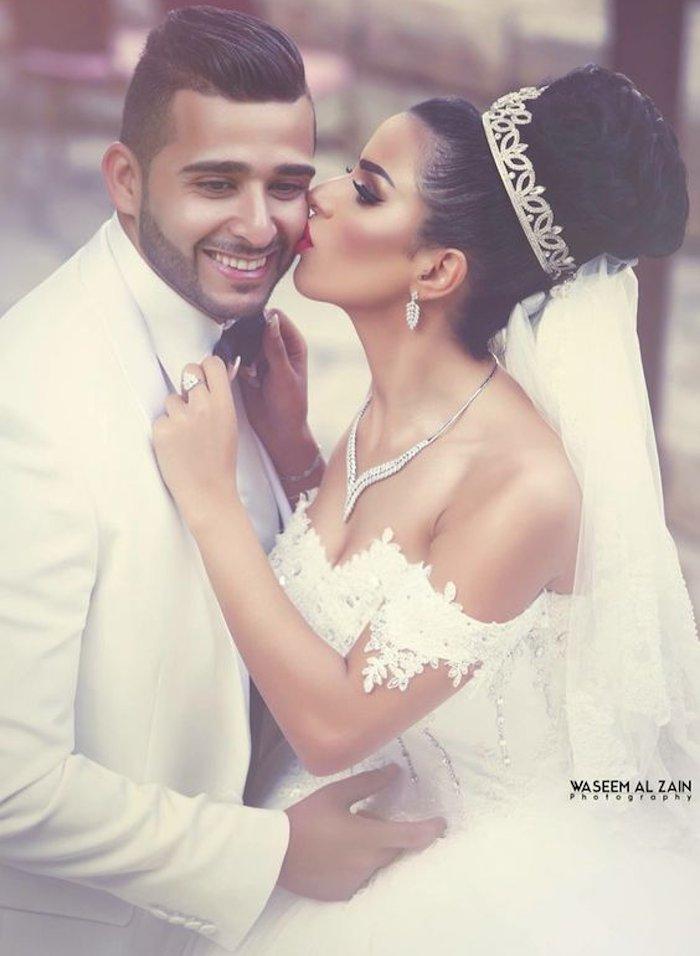 bride kissing to groom on cheek - best kisses image