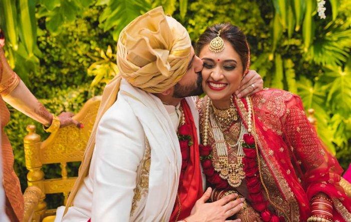 groom kissing bride cheek - sweet kiss image
