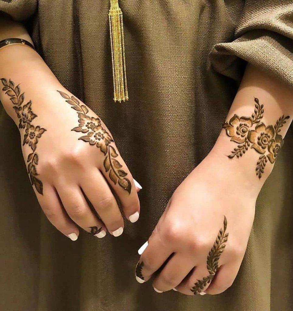 Asymmetrical Flower Mehendi Design All Over The Back Of The Hand