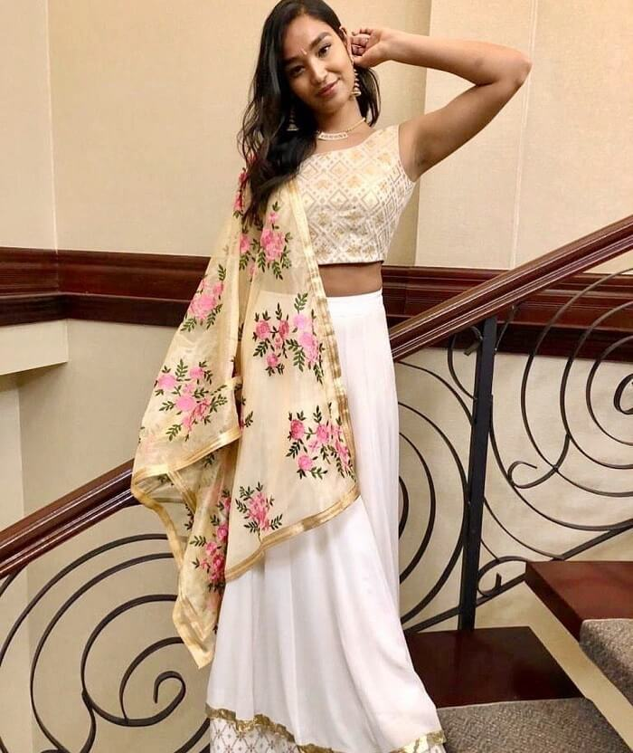 white and golden lehenga with floral floral