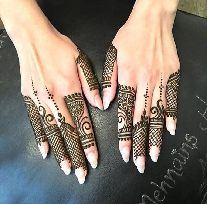 criss cross finger mehndi design